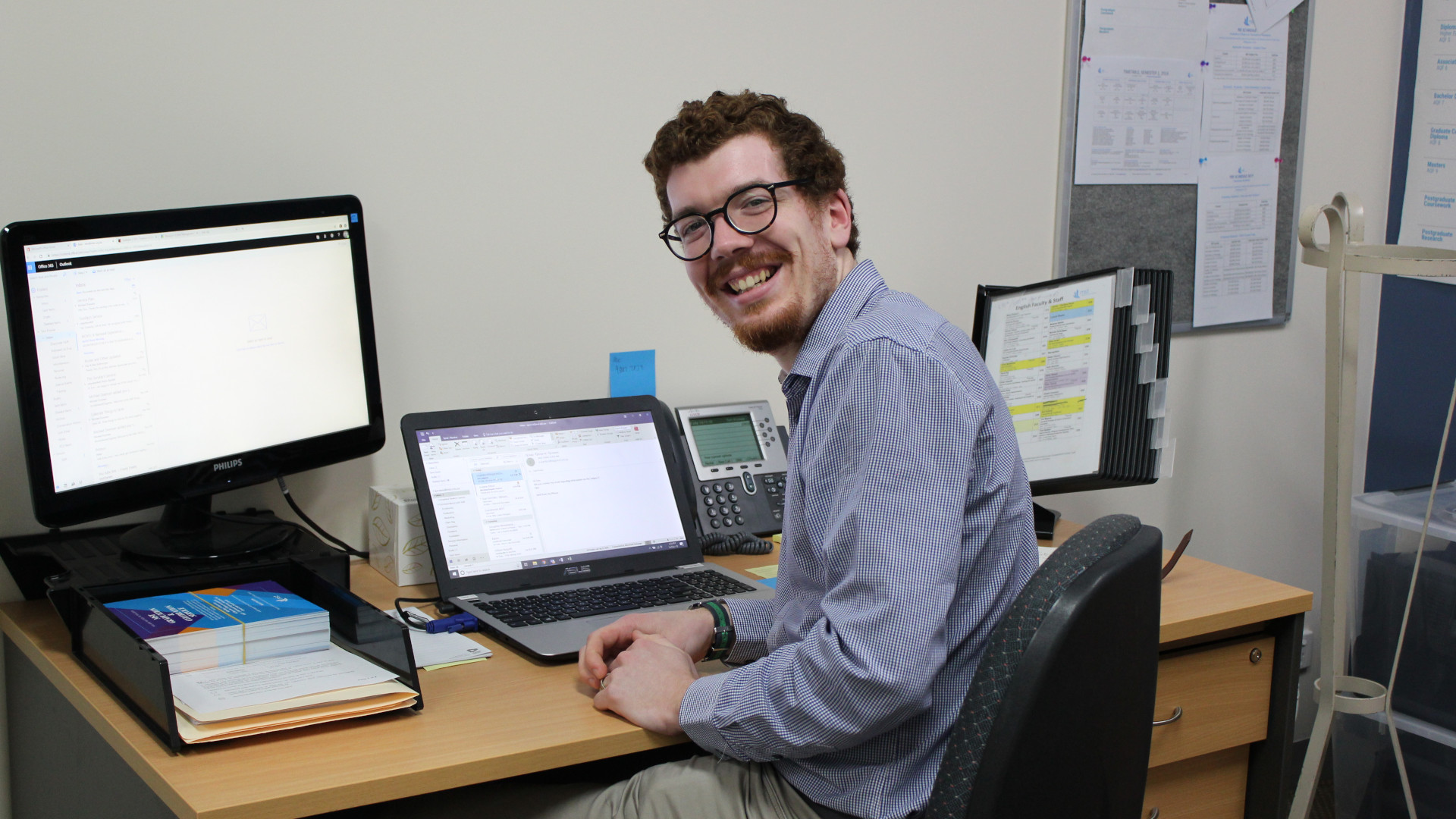 Tom Prowse sitting in his office at a desk