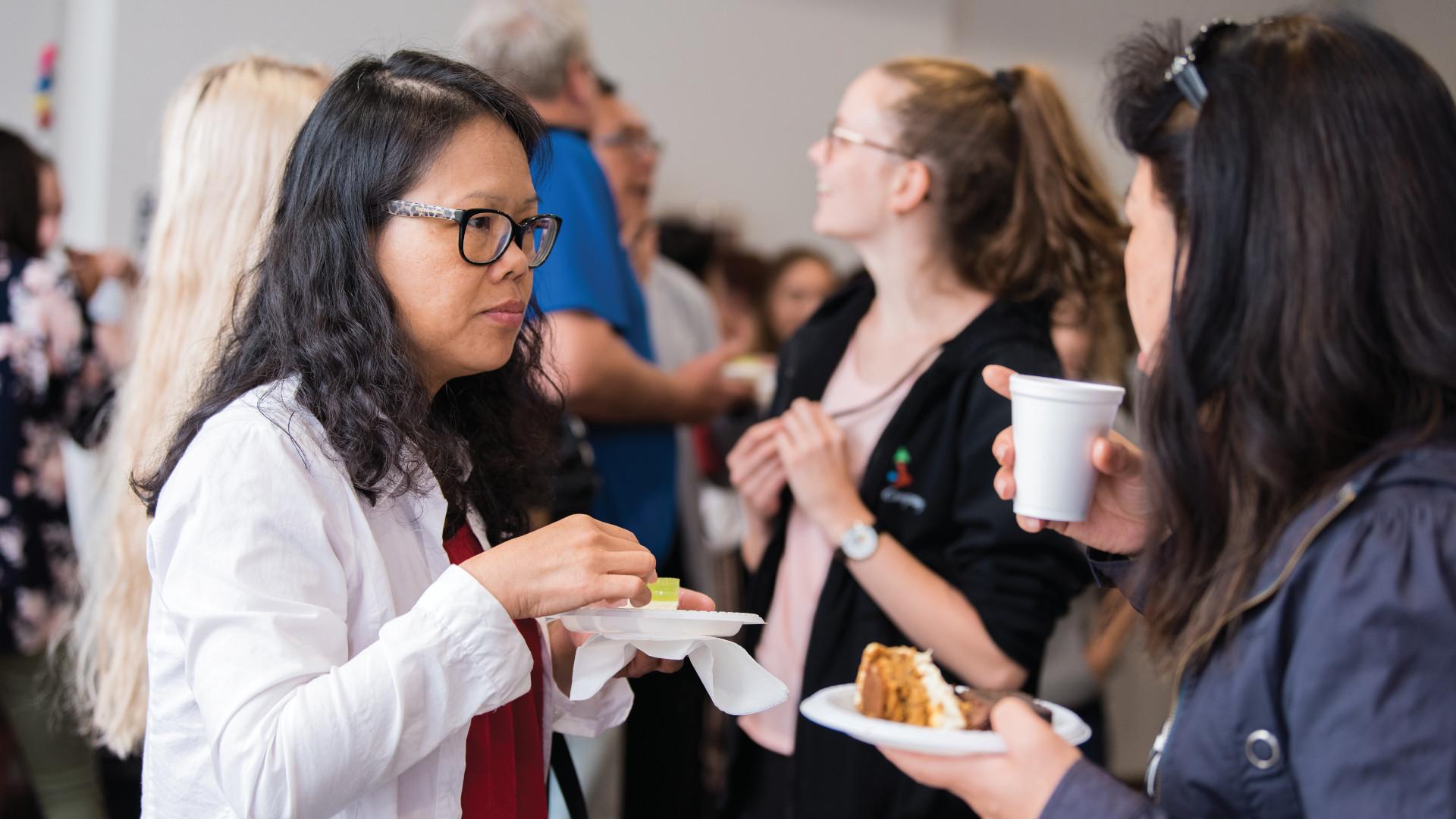 Two Asian women eating
